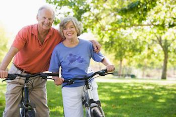 Couple on bikes | Dentures in Poway CA | AllDent Dental Center