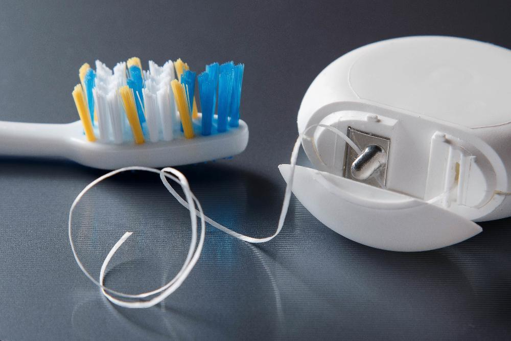 Floss and tooth brush | Dentist in Poway CA