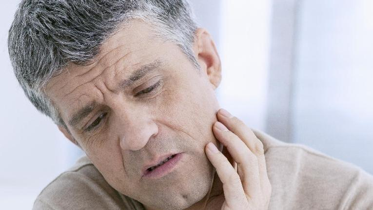 Man mourning his missing teeth | Tooth Replacement in Poway CA | AllDent Dental Center