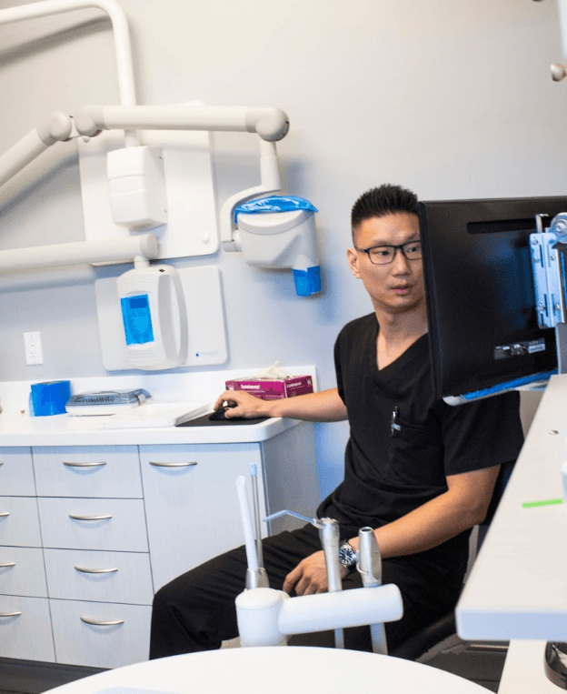 dr. chung looking at x-rays | dentist poway ca